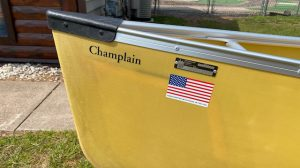 Wenonah Champlain – Aramid Ultra-Light, VersiGunwales, Removable Ash Yoke, Aramid Bucket Sliding Bow and Stern Seats, Foot Brace, Internal Felt Skid Plates – Blem