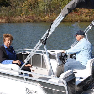 Paddle King – 2021 Lo Pro Angler Mini Pontoon Boat with Half Gate, Side Lounge, Middle Swivel Fishing Seat and Custom Trailer – Black/Charcoal/Grey