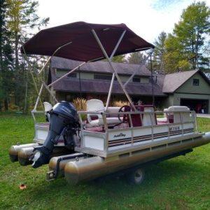 Used – 2009 Paddle King Lo Pro Cruiser II, Custom Bunk Trailer, Canopy, Boot, Mooring Cover, 2012 Yamaha 20 hp. Motor